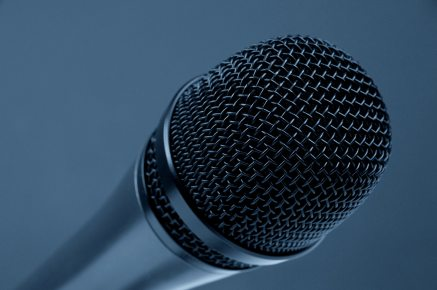 Microphone on blue background