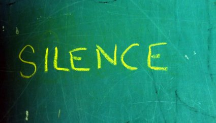 Yellow silence on green chalkboard
