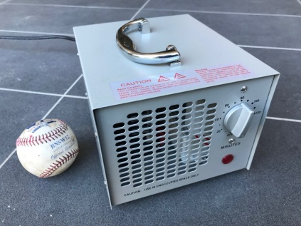 Small ozone generator next to baseball