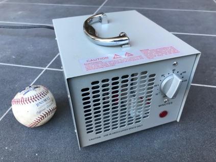 Small ozone generator next to baseball